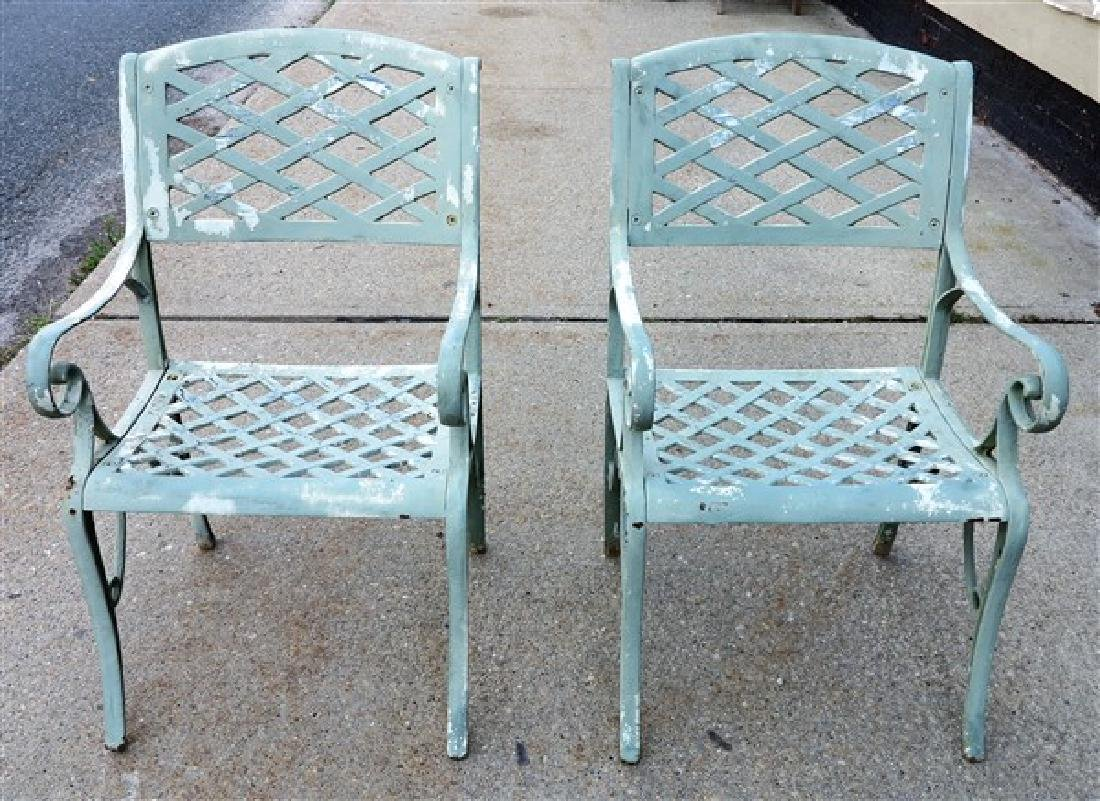 Pair of Cast Iron Arm Chairs
