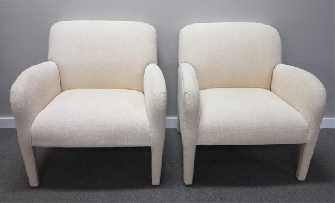 Slick clean pair of upholstered arm chairs
