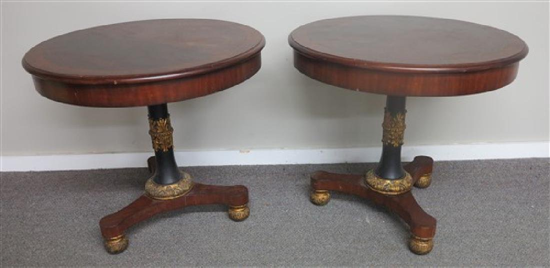 Pair of mahogany and gilt decorated center tables