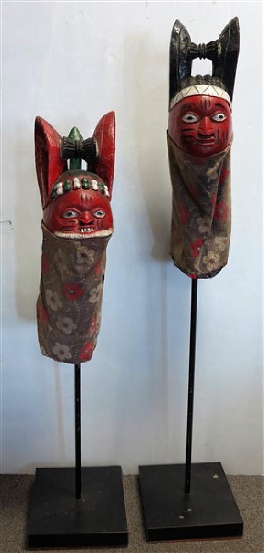 2 mounted fertility masks