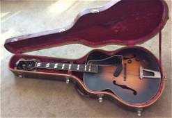 Gibson guitar and premium speaker
