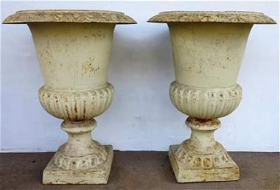 """Pair 26"""" cast iron urns"""
