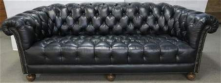 Beautiful tufted black leather chesterfield