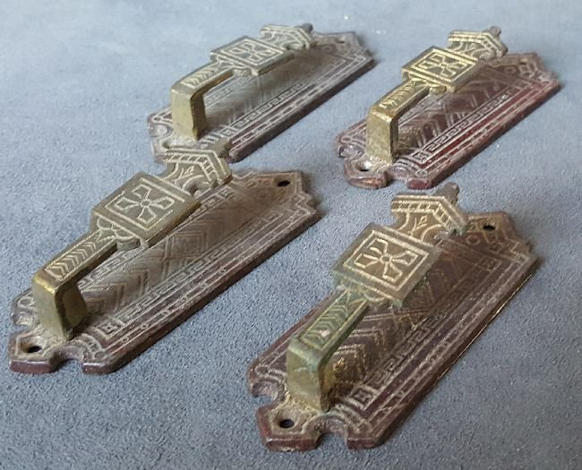 Four Bronze Picture Hangers