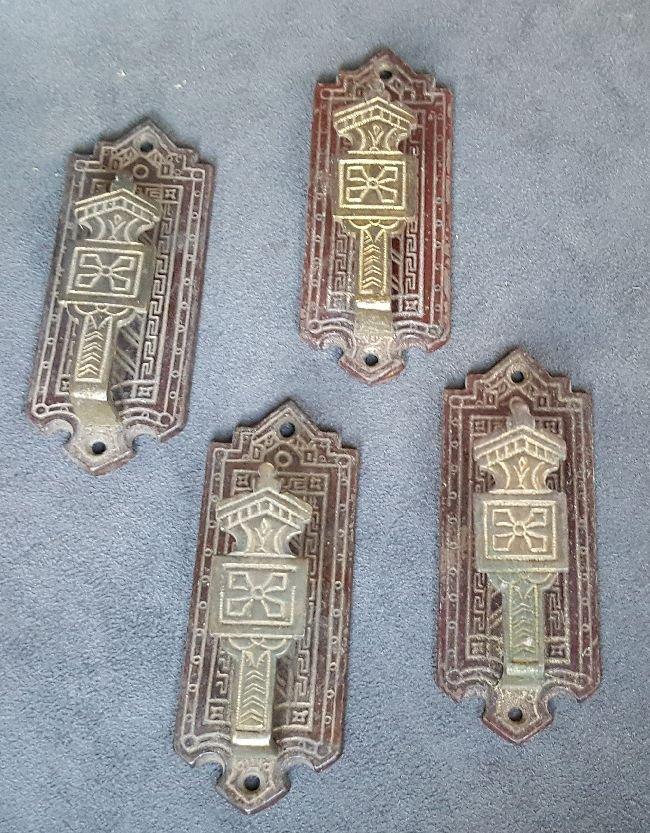 Four Bronze Picture Hangers - 4
