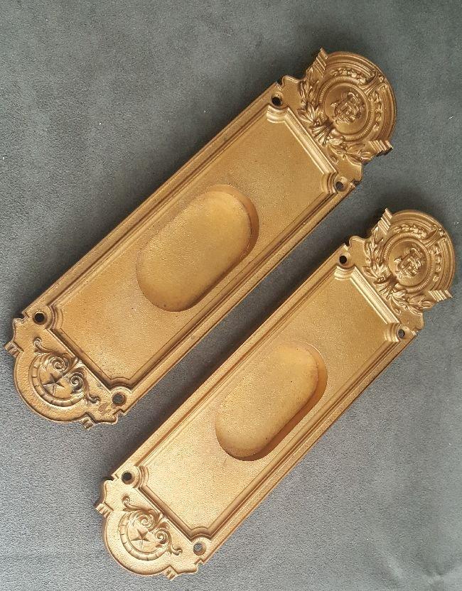 Pair of Bronze Finger Plates