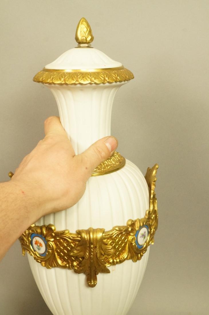 Pr White Porcelain Bisque Urns. Gilt metal mounts - 9