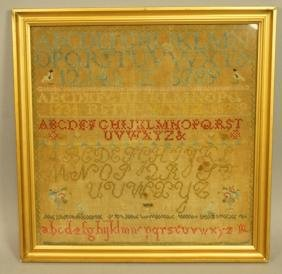 Antique Alphabet Sampler.  Framed under glass.