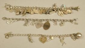 3 Sterling Charm Bracelets.  Full with 800 and st