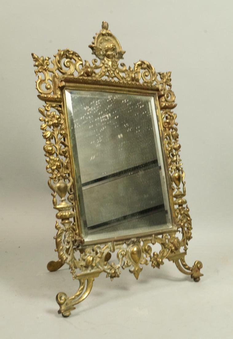 Antique Brass Framed Mirror. Standing Easel const
