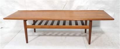 GRETE JALK Style Danish Teak Coffee Table. Rolled