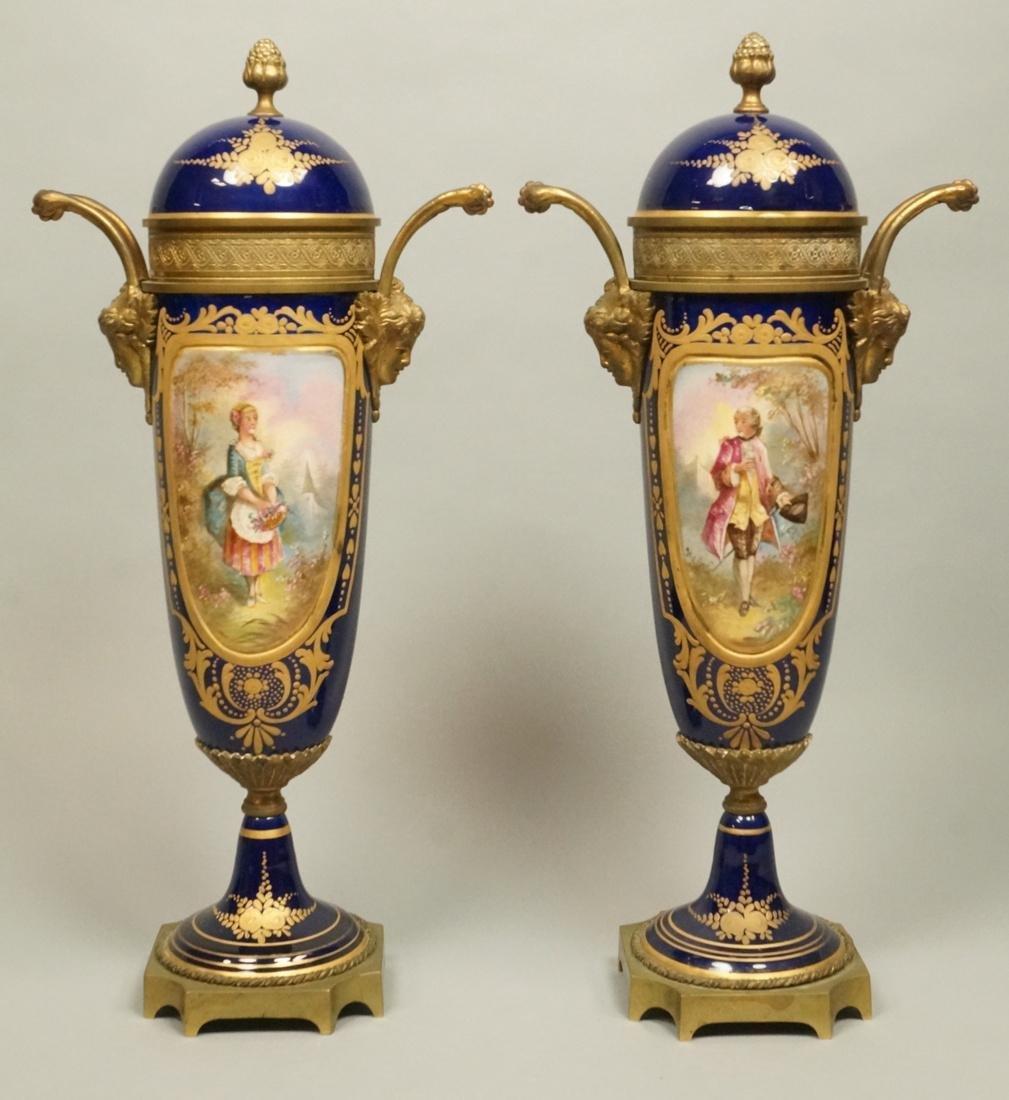 Pr Sevres Style Bronze Mounted Porcelain Urns. Co