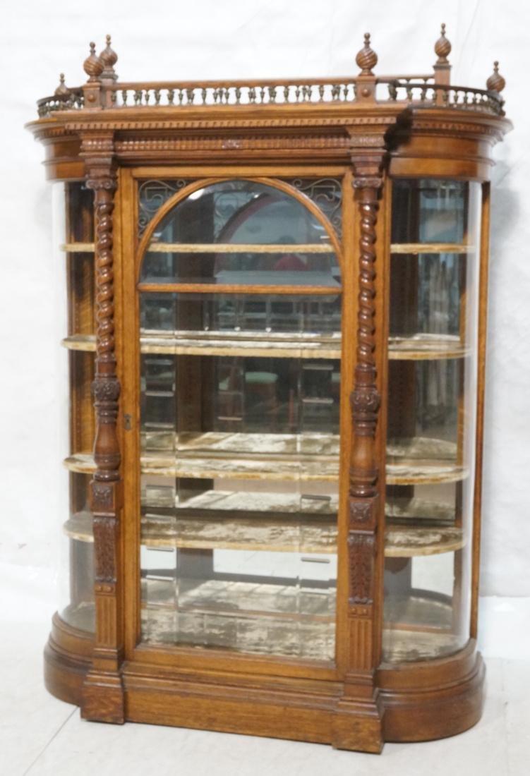 Bowed Side Antique Oak China Cabinet. Richly carv