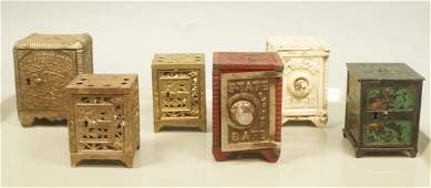 6 Cast Iron Vintage Safe Banks. Includes children