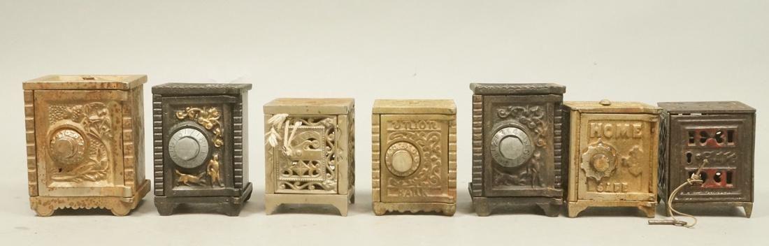 7 Vintage Cast Iron Safe Banks. Some key lock, so