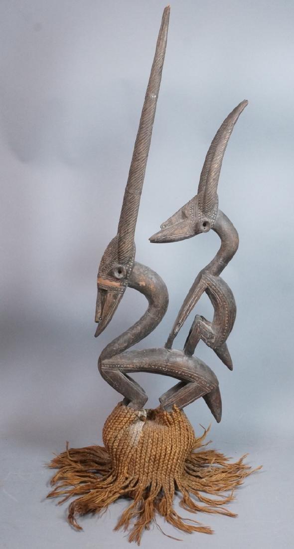 Lg Carved Wood African Sculpture. 2 long horn gaz