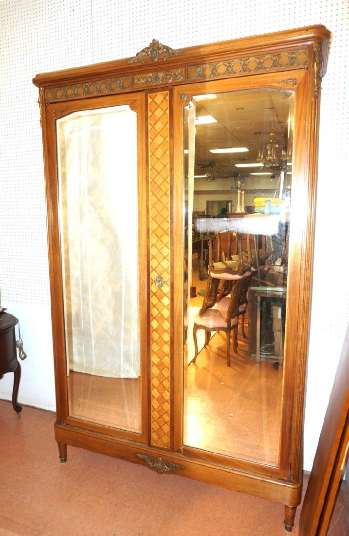 French Inlaid Armoire. Double beveled doors. Cont