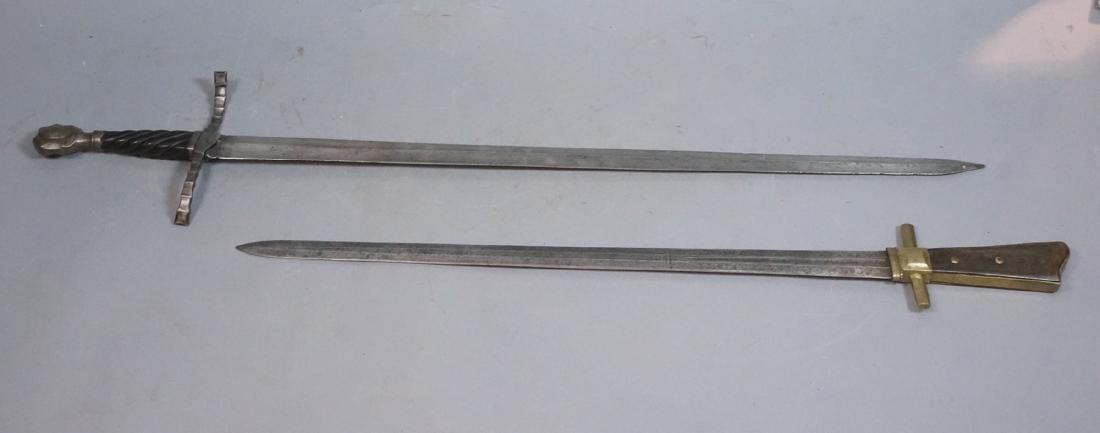 2 Vintage Swords. One steel blade marked E.N. Tol