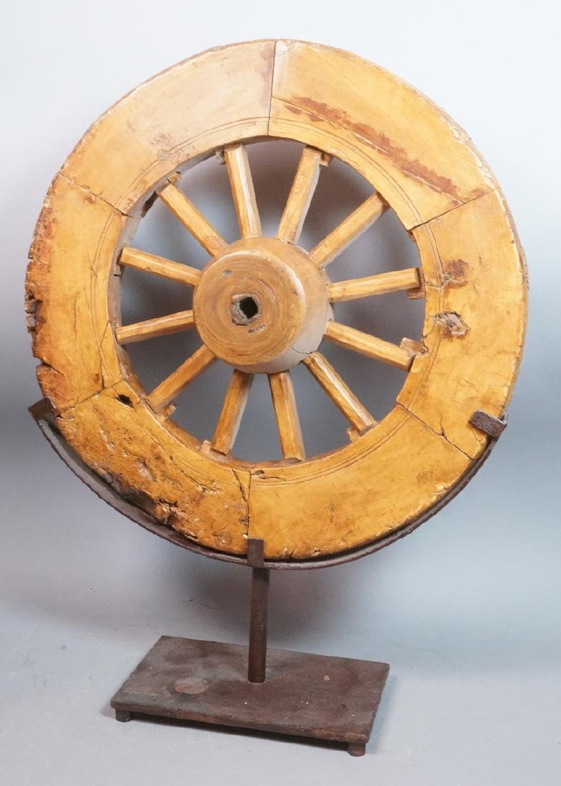 Antique Wood Wheel on Iron Stand. Industrial Scul
