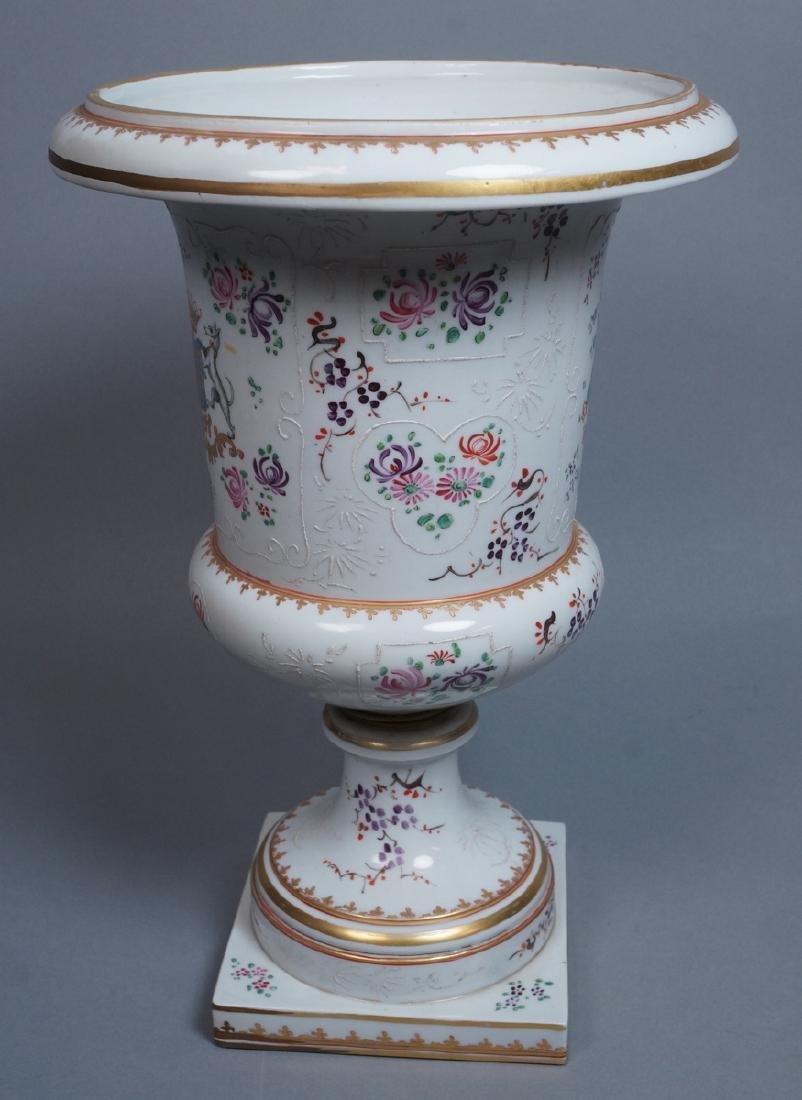 Lg Porcelain Urn. Flared rim form bolted to pedes