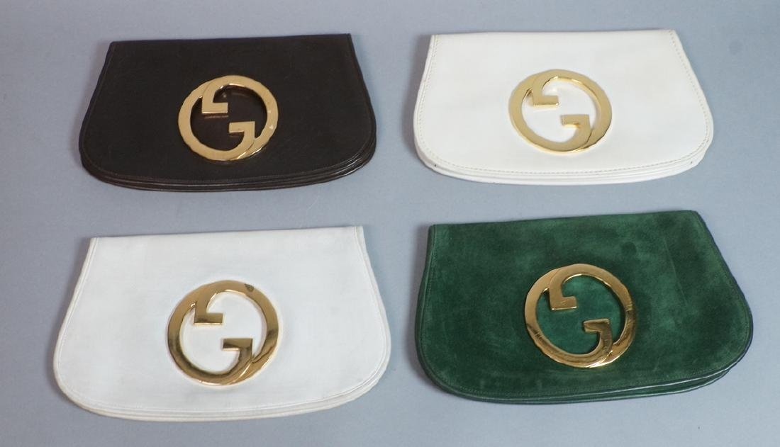 4 GUCCI Italian Leather Clutches. All gold tone d