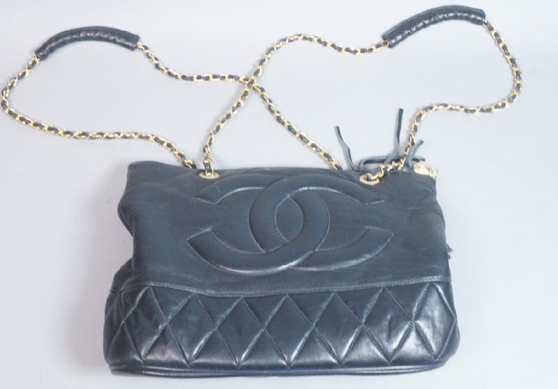 Black Leather CHANEL Handbag. Quilted bag and dou