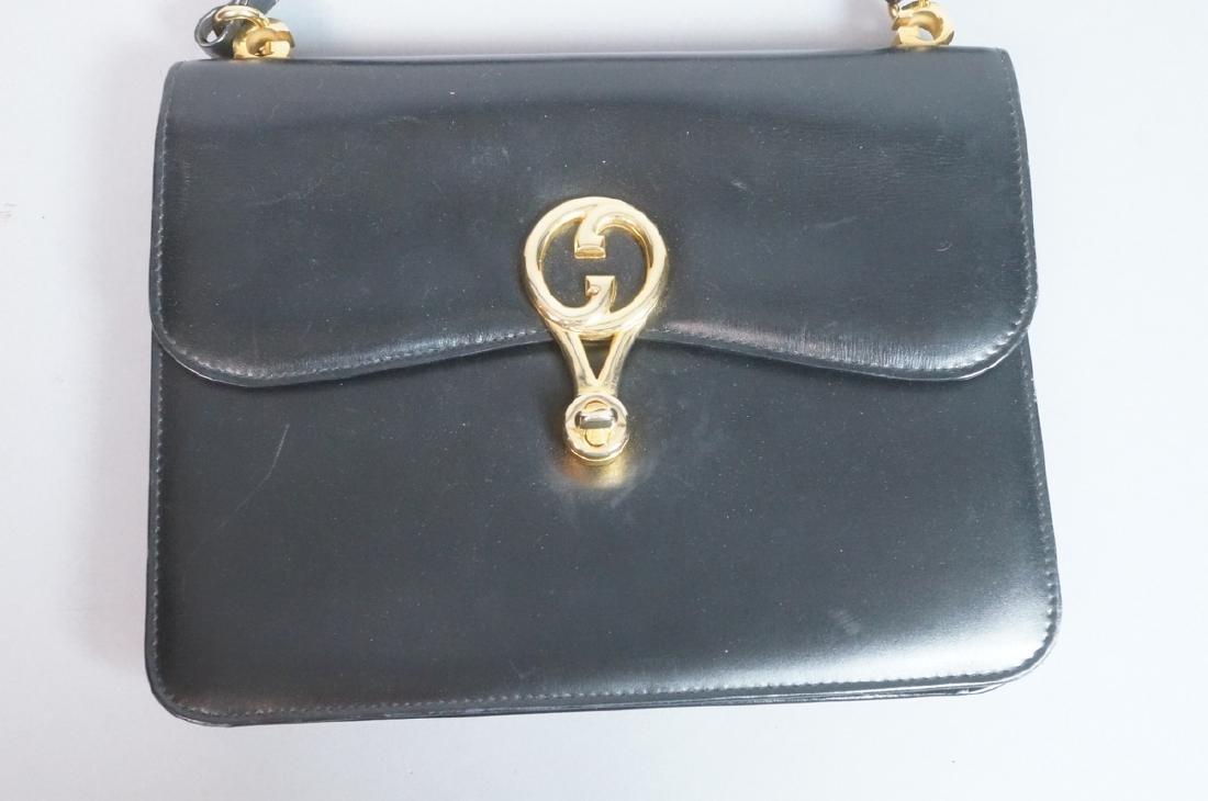 Black Leather GUCCI Handbag. Hand strap converts