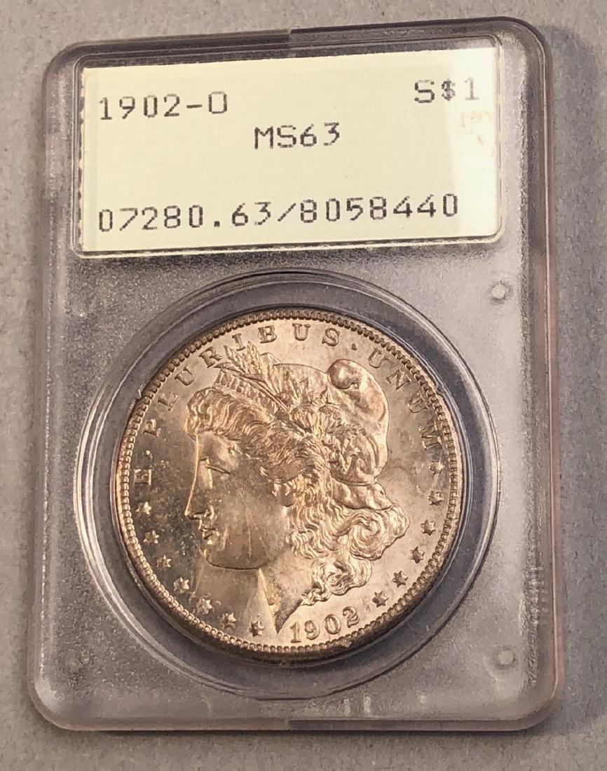 1902-O Morgan Silver American Dollar. In Old grad
