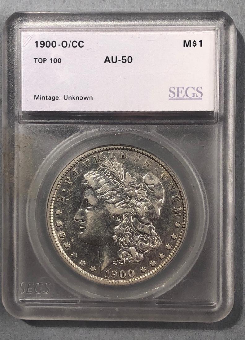 1900 O/CC SEGS AV50 Morgan Dollar