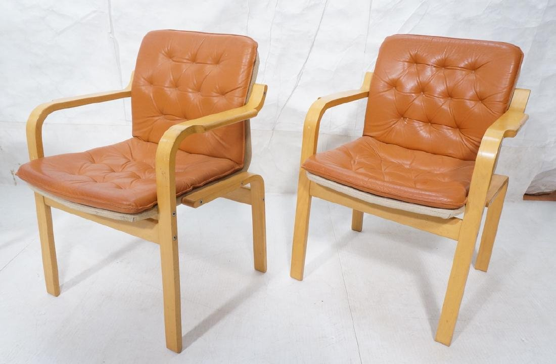 Pair of Modernist Lounge Chairs.  Molded wood fra