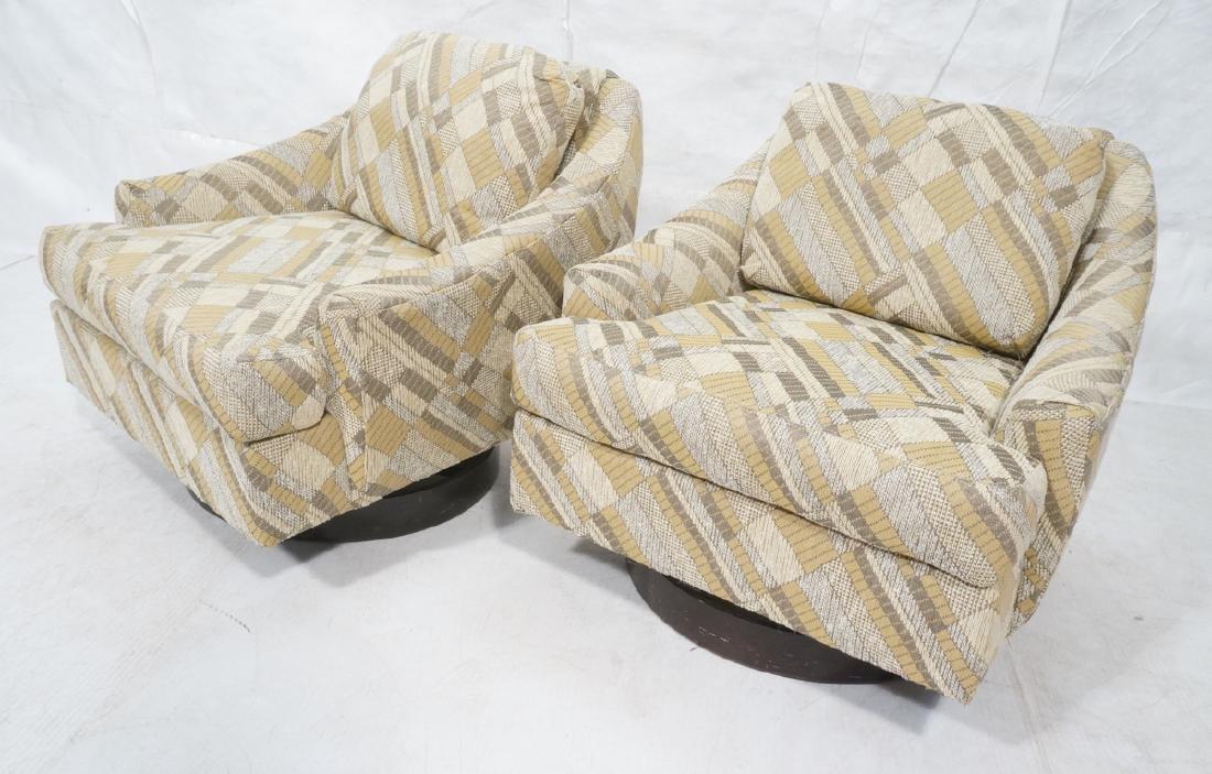 Pr SELIG Modern Swivel Lounge Chairs. Sloped arm