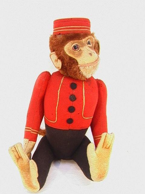 1001: Antique Schuco Nodding Mechanical Bellboy Monkey.