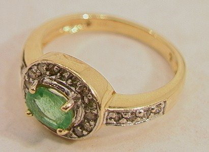 100: 14K Emerald and Diamond Ring.  One large emerald a