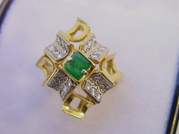 102: 18K Modernist Gold Ring with Emerald and Diamonds.