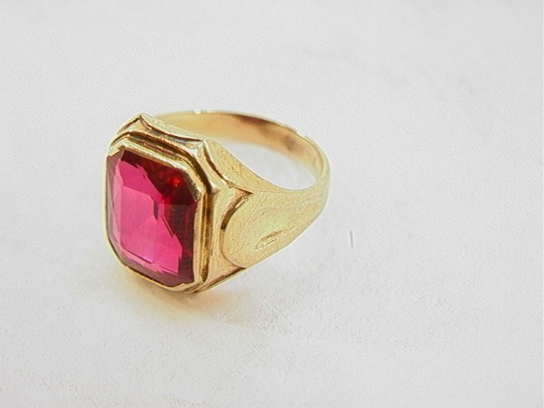 107: 14K Gold Mans Ring With Red Stone.  Tested Gold.