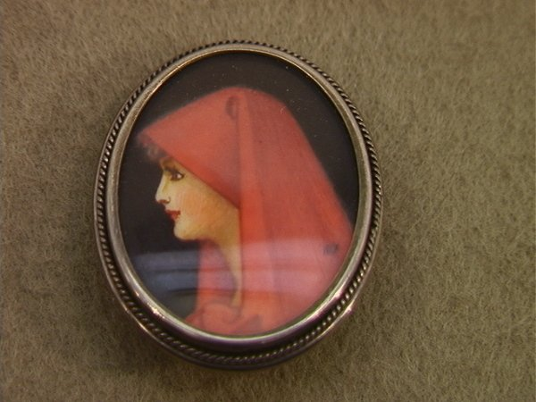 114: 800 silver Pin with Painted Portrait. Artist initi