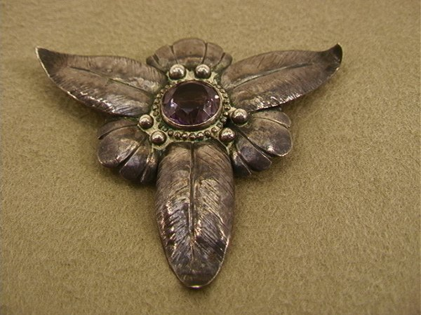 117: Arts And Crafts Sterling Floral Pin with Amethyst.