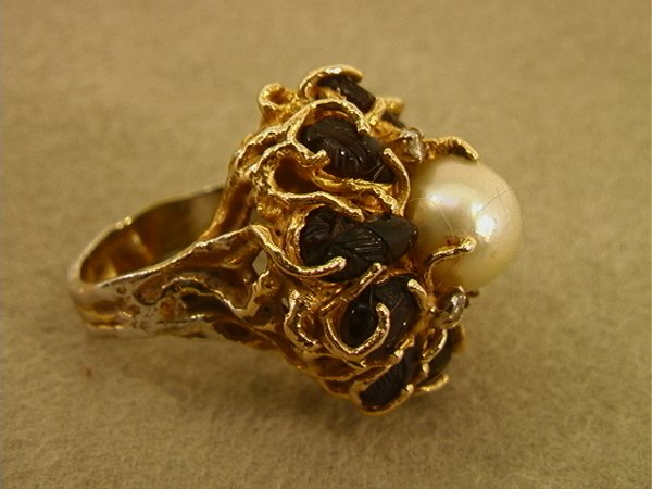 130: 14K Tested Gold Ring Diamonds Garnets and Pearl.