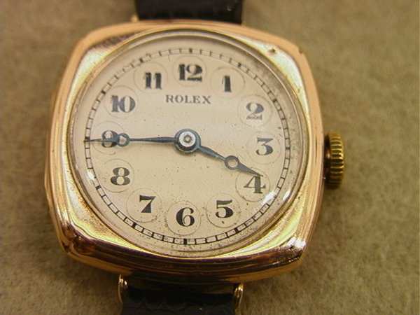 154: 10K Gold Ladies Rolex Watch.  Replaced leather ban