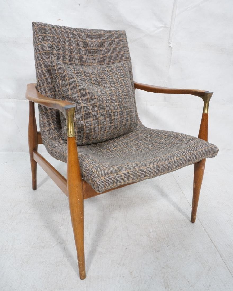 Mid Century Modern Lounge Chair. Stylized arms &
