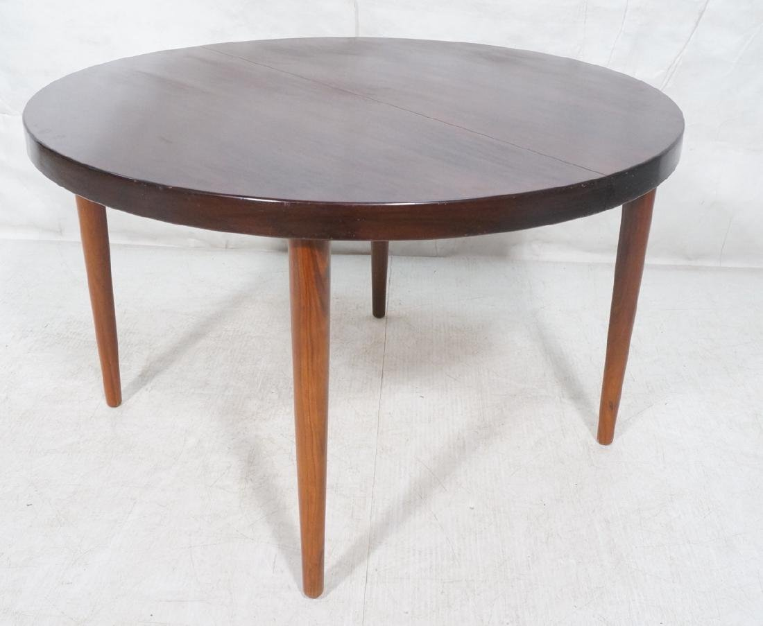 Round Rosewood Modernist Dining Table. Tapered le