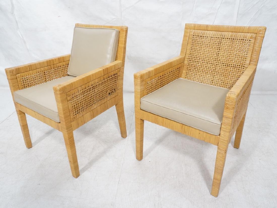 Pr Woven Rattan Arm Lounge Chairs. Beige vinyl se