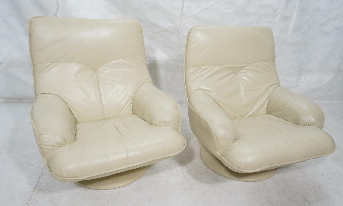 Pr Beige Leather Swivel Lounge Chairs. Completely