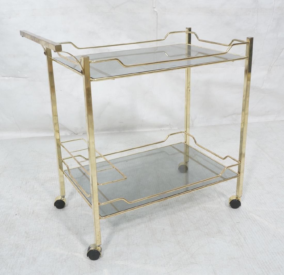 Gold tone Metal Rolling Bar Cart. Glass shelves o