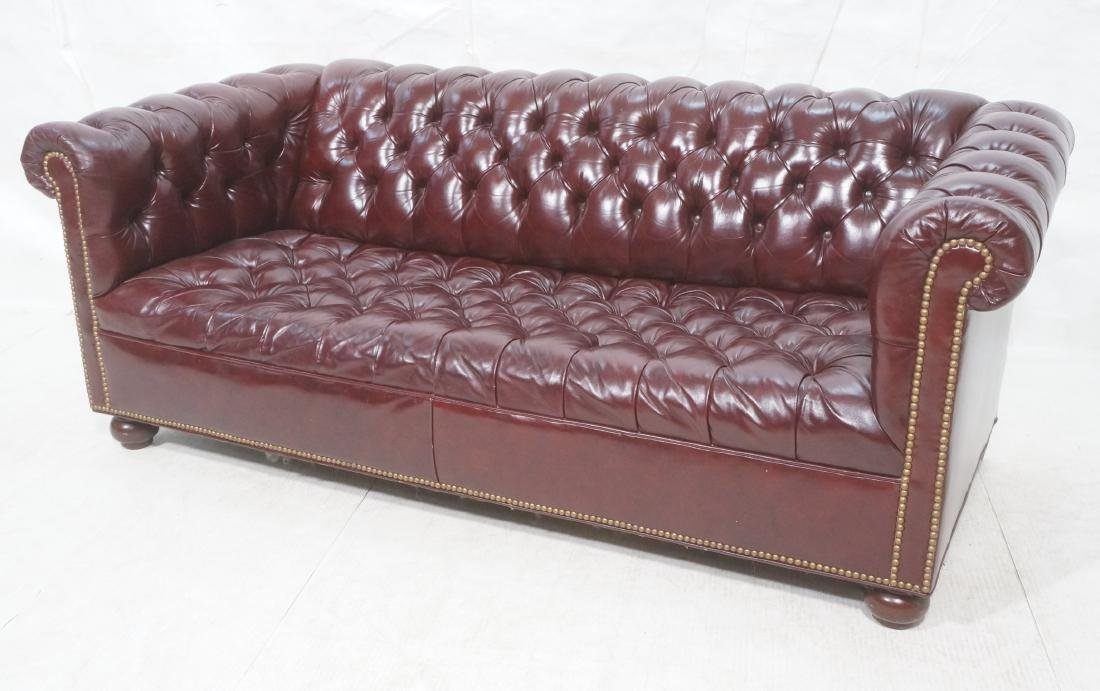 Burgundy Leather Chesterfield Couch. Brass tack t