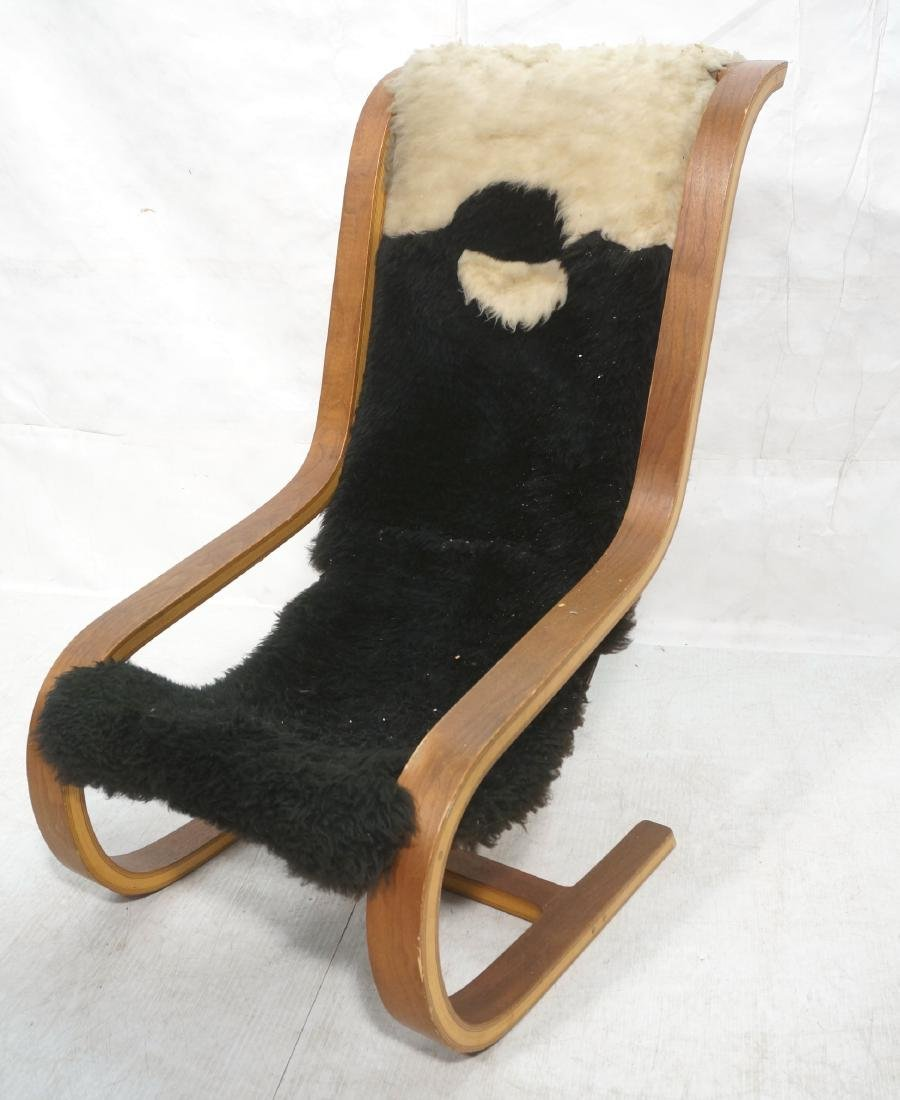 Modernist Tall Back Laminated Wood Lounge Chair.