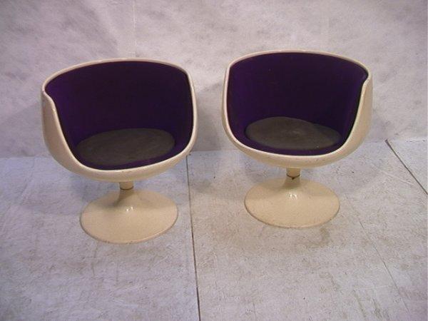 237: Pair Eero Aarnio Cognac Fiberglass Chairs.  Molded