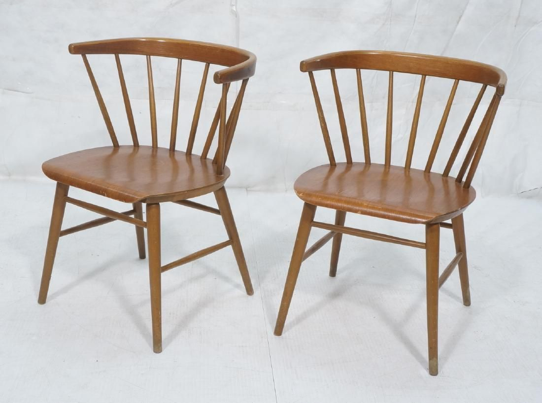 2 Modernist Spindle Back Captains Chairs. Barrel
