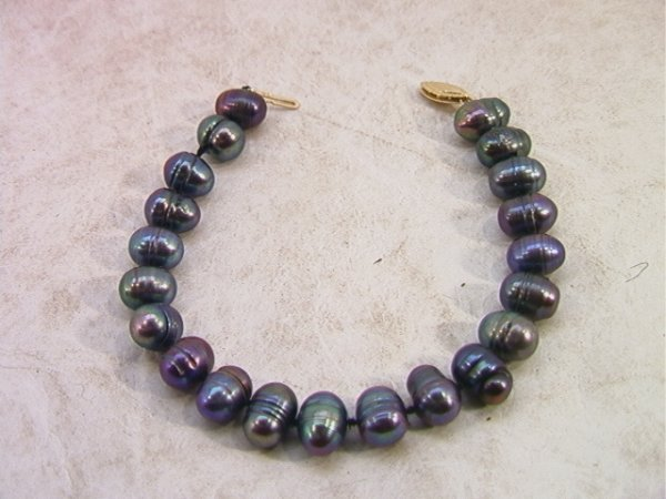 510: 14K Gold and Black Baroque Pearl Bracelet. Pearls