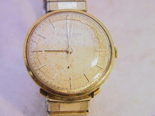 514: 14K Gold Schaffhausen International Mans Watch.